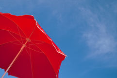 Red beach umbrella and blue sky Royalty Free Stock Photography