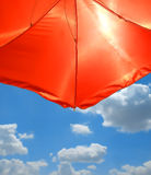 Red Beach Umbrella over blue sky Royalty Free Stock Photo