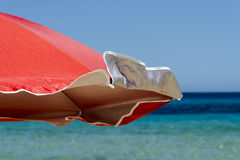 Red beach umbrella Royalty Free Stock Photography