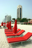 Red beach umbrellas. Modern hotels and umbrellas on Miami beach Stock Photography