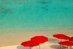 Red beach umbrellas Royalty Free Stock Photography