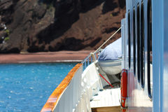 Red Beach Yacht. A view from the port side of a yacht looking at the dark red beach of Rabida, Galapagos Islands Stock Photography