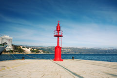 Red beacon. On the pier Royalty Free Stock Photo
