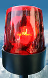 Red beacon light. Emergency red beacon light on blue sky background Stock Photo
