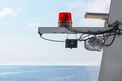 Red beacon light on white mast ship Stock Photos