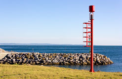 Red Beacon on the Shore Stock Image