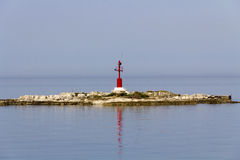 Red beacon on smallest island Royalty Free Stock Photo
