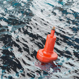 Red beacon on water surface closeup Royalty Free Stock Images
