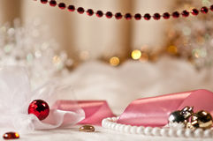 Red bead and christmas balls with ribbon. Royalty Free Stock Image