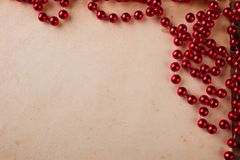 Red bead garland on paper Royalty Free Stock Photos