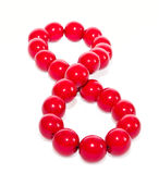 The red bead laid out as a figure eight Stock Images