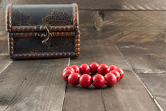 Red bead made from wood on color wooden background Stock Images