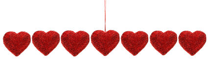 Red beaded hearts isolated against white stock photo