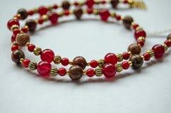 Red beaded jewellery close up stock photos