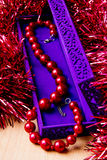 Red beads. In lilac box Stock Image
