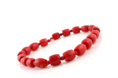 Red beads. On white background Royalty Free Stock Photos