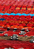 Red Beads. Table of red beaded jewelry at an Indian market in Ecuador Stock Image