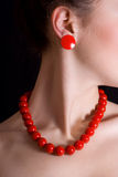 Red beads around her neck. Red beads and a round shackle around his neck a beautiful girl stock photos