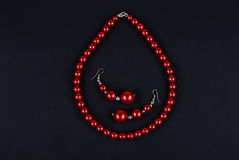 Red beads on a black Stock Photos