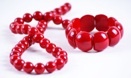 Red beads and bracelet Stock Photos