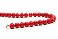 Red beads isolated on white Royalty Free Stock Photo
