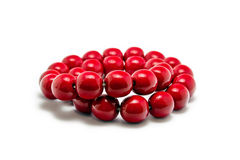 Red beads isolated on white background. Juicy red beads lying on a white background Royalty Free Stock Image