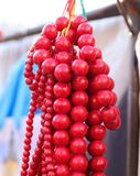 Red beads on the market window. Close-up, side view, cropped shot stock photos