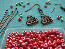 Red beads and pieces for making earrings, handmade jewelry Royalty Free Stock Photography
