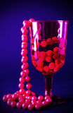 Red beads in red glass Stock Images
