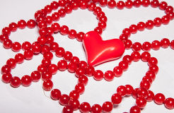 Red beads and red heart Royalty Free Stock Images