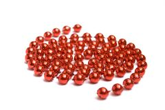 Red beads on white background Stock Images