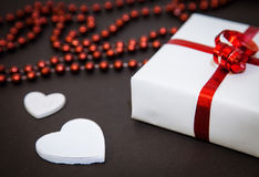 Red beads, white hearts and gift Royalty Free Stock Images