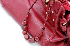Red beads and woman's bag Royalty Free Stock Images
