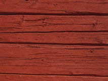 Red beamed wall. Scandinavian wooden beamed wall painted with traditional falu red paint Stock Photo