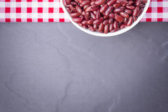 Red bean in bowl isolated. On black background,Top view. And close up Royalty Free Stock Photos