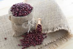 Red bean on hemp sack. With wood background stock photo