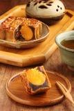 Red bean paste single yolk moon cake. Sliced red bean paste moon cake with yolk Royalty Free Stock Image
