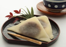 Red Bean Paste Wrapped in Cinnamon-flavored Dough Yatsuhashi, Japanese Kyoto sweets. Type of sweet made with bean paste local delicacy in Kyoto; cinnamon Stock Image