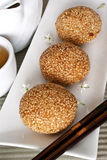 Red Bean Pastries with Sesame Seeds. A Chinese dessert that is made from glutinous rice flour stuffed with a red bean paste filling and deep fried in hot oil Royalty Free Stock Images