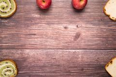 Red bean and raisin bread with red apple composition backgrounds on wooden table food and drink concept with copy space Royalty Free Stock Images