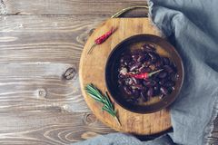 Red bean stew served in a bowl, cutting board, napkin. Top view, copy space. stock photography