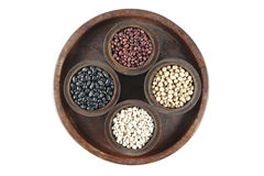 Red Beans, black beans, millet and  black eyed peas in wood bowl set on wood background. Royalty Free Stock Photos