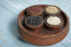 Red Beans, black beans, millet and  black eyed peas in wood bowl set Royalty Free Stock Photography