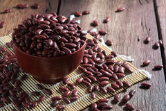 Red beans in a cup. On a wooden floor Royalty Free Stock Photos