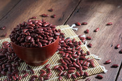 Red beans in a cup. On a wooden floor Stock Photography