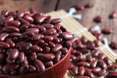 Red beans in a cup. On a wooden floor Royalty Free Stock Images