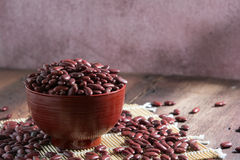 Red beans in a cup. On a wooden floor Royalty Free Stock Image
