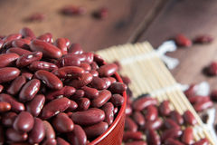 Red beans in a cup. On a wooden floor Royalty Free Stock Photography