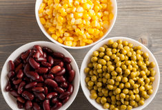 Red beans, green peas and sweet corn in white bowls Royalty Free Stock Image
