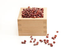 Red beans in Japanese sake cup called Masu Royalty Free Stock Image